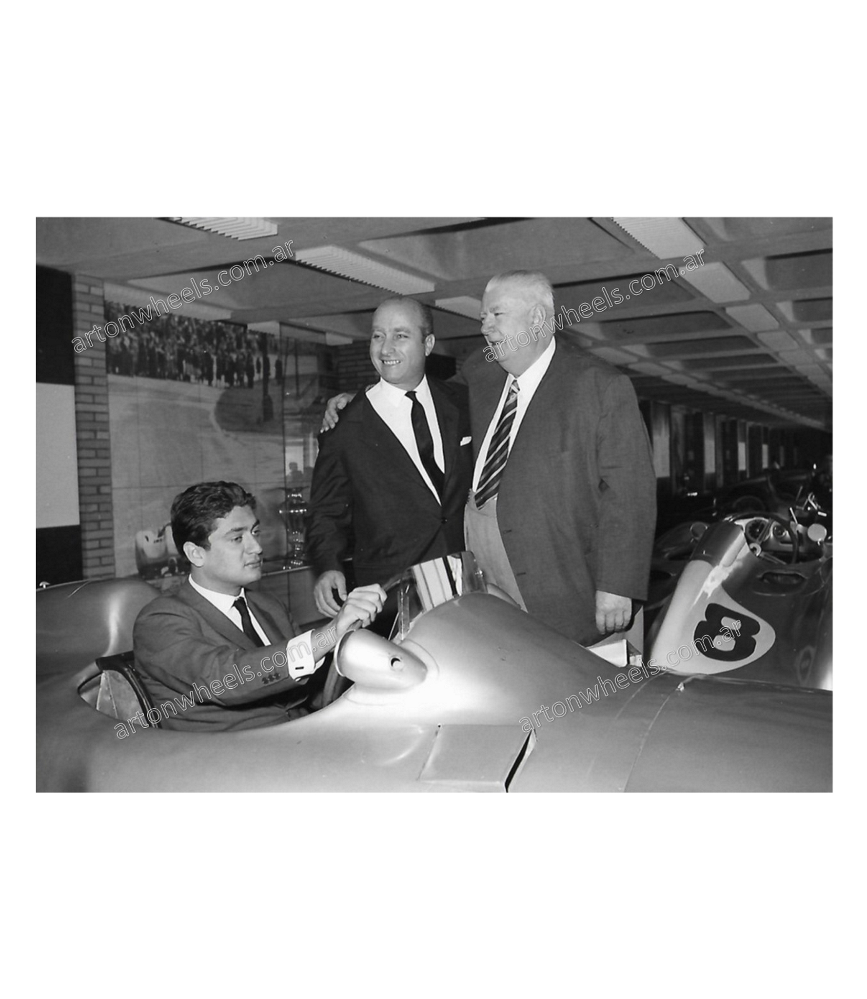 Fangio, Neubauer and Bordeu photo with the Mercedes w196